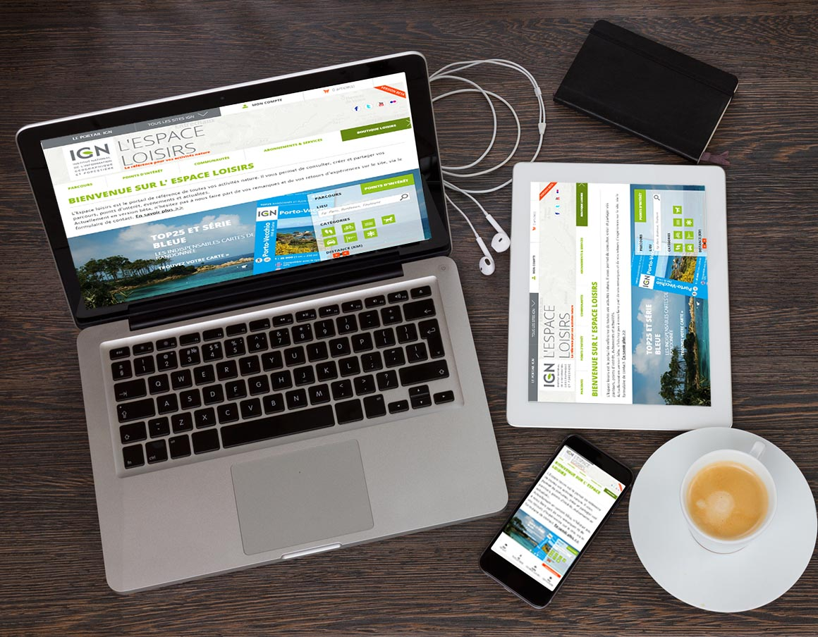 set of modern computer devices - laptop, tablet and phone with cup of coffee